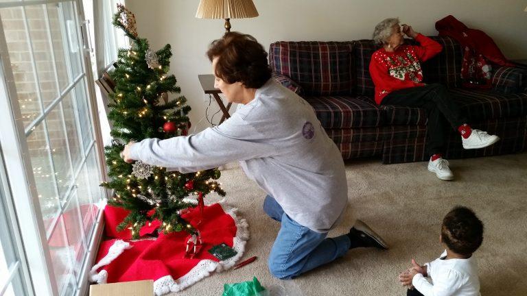 Washington-Rockville Elks Lodge members decorating a Christmas tree for the veteran's home.